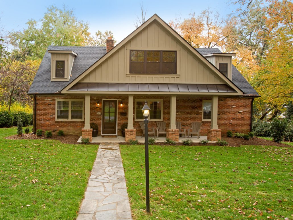 brick cape code home remodel with columns